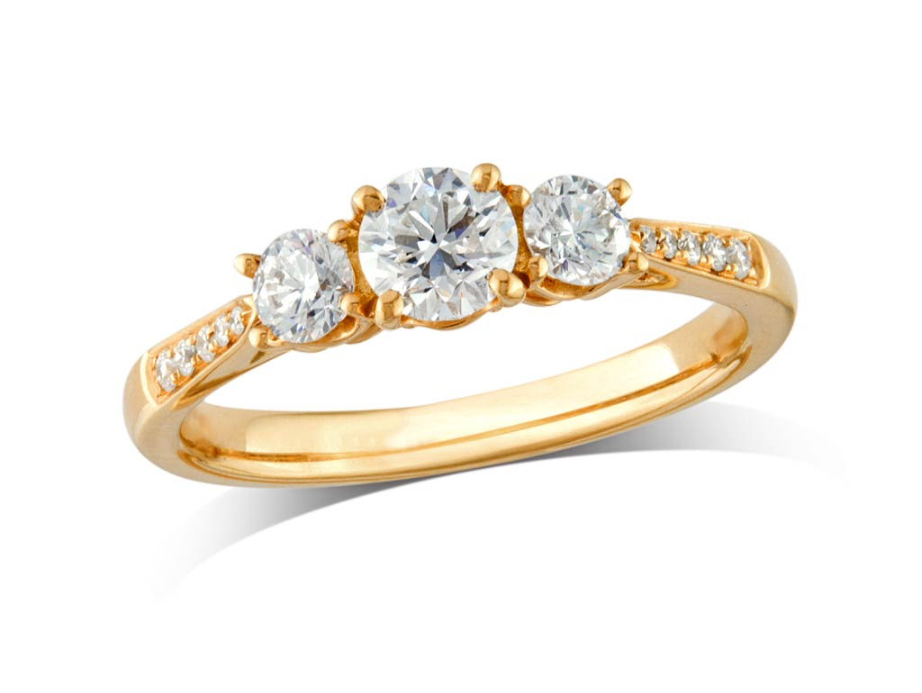 A 0.32ct centre, Brilliant, F, Three stone diamond ring. You can buy online or reserve online and view in store at Michael Jones Jeweller, Banbury