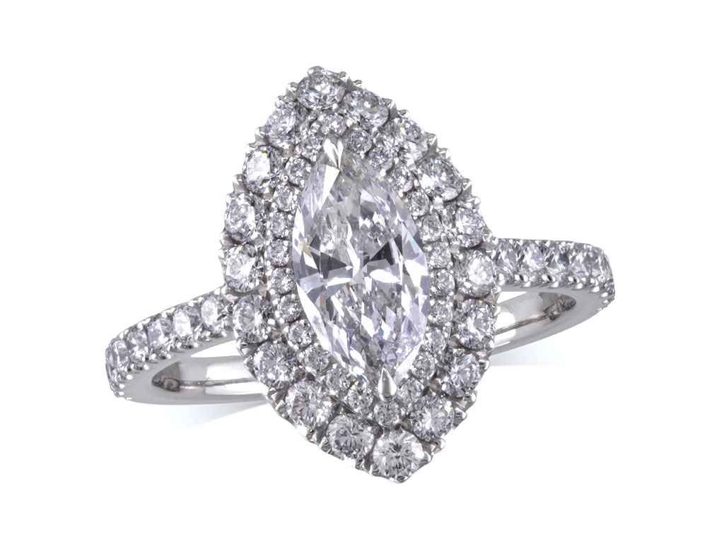Platinum set diamond cluster engagement ring, with a certificated marquise cut centre in a two claw setting, with a surrounding diamond set double bezel and diamond set shoulders. Total cluster diamond weight: 1.32ct.