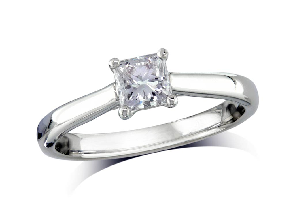 Platinum set single stone diamond engagement ring, with a certificated cushion cut, in a four claw setting. Perfect fit with a wedding ring.