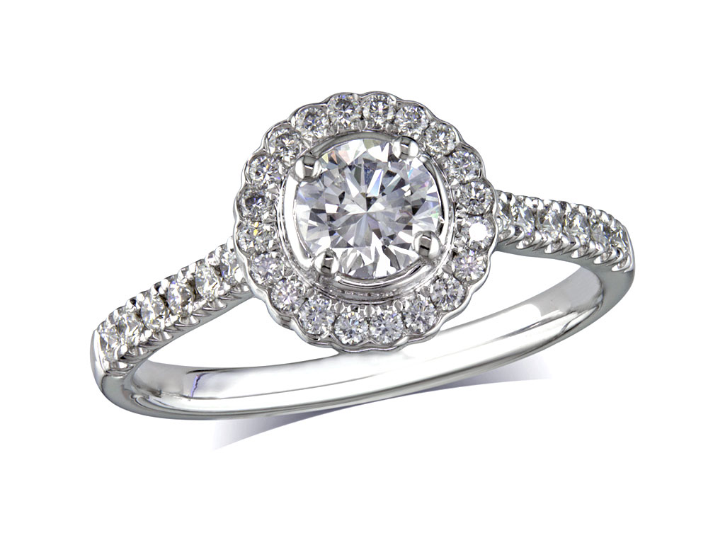 Platinum set diamond cluster engagement ring, with a certificated brilliant cut centre in a four claw setting, with a surrounding diamond set bezel and diamond set shoulders. Perfect fit with a wedding ring. Total cluster diamond weight: 0.84ct.