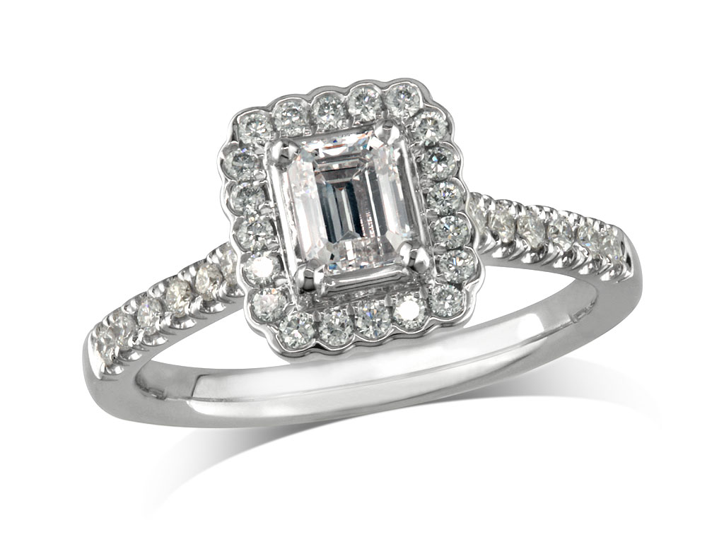 Platinum set diamond cluster engagement ring, with a certified emerald cut centre in a four claw setting, with a surrounding diamond set bezel and diamond set shoulders. Perfect fit with a wedding ring. Total cluster diamond weight: 0.82ct.
