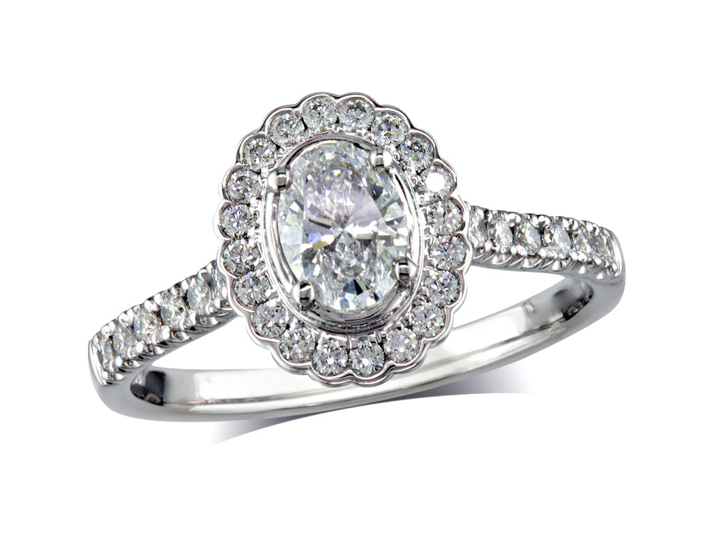 Platinum set diamond cluster engagement ring, with a certificated oval cut centre in a four claw setting, with a surrounding diamond set bezel and diamond set shoulders. Perfect fit with a wedding ring. Total cluster diamond weight: 0.82ct.