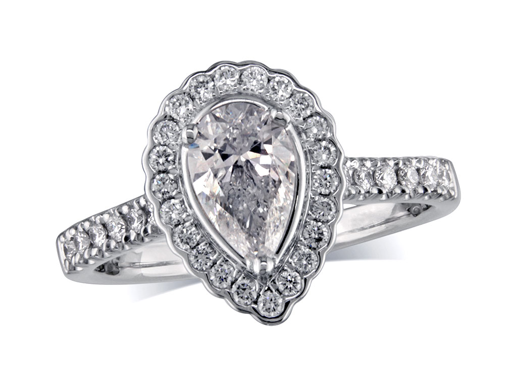 A 0.70ct centre, Pear, G, Cluster diamond ring. You can buy online or reserve online and view in store at Michael Jones Jeweller, Banbury