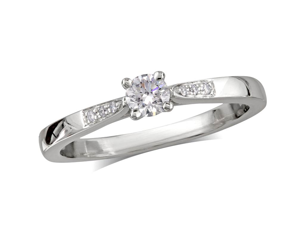 Platinum set single stone diamond engagement ring, with a certificated brilliant cut centre in a four claw setting, and diamond set shoulders. Perfect fit with a wedding ring. Total diamond weight: 0.25ct.