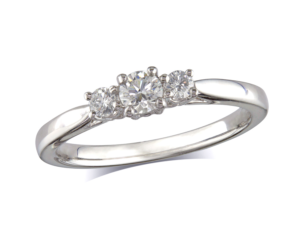 Platinum set three stone diamond engagement ring, with a certificated brilliant cut centre in a four claw setting, and one brilliant cut on each shoulder. Perfect fit with a wedding ring. Total diamond weight: 0.32ct.