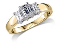 18 carat yellow gold set three stone diamond engagement ring, with a certificated emerald cut centre in a four claw setting, and one emerald cut on each shoulder. Total diamond weight: 0.75ct.