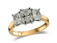 18ct yellow gold set, three stone diamond ring with a certificated Radiant cut centre diamond in a four claw setting, with two radiant cut diamonds either side. Total diamond weight: 1.02ct.
