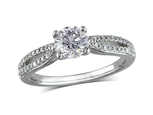 Platinum set single stone diamond engagement ring, with a certificated brilliant cut centre in a four claw setting, and diamond set shoulders. Perfect fit with a wedding ring. Total diamond weight: 0.88ct.