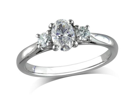Platinum set three stone diamond engagement ring, with a certificated oval cut centre in a four claw setting, and one brilliant cut on each shoulder. Total diamond weight: 0.38ct.