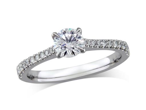 Platinum set single stone diamond engagement ring, with a certificated brilliant cut centre in a four claw setting, and diamond set shoulders. Total diamond weight: 0.73ct.