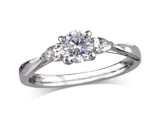 Platinum set single stone diamond engagement ring, with a certificated brilliant cut centre in a four claw setting, and one pear cut on each shoulder. Perfect fit with a wedding ring. Total diamond weight: 0.67ct.