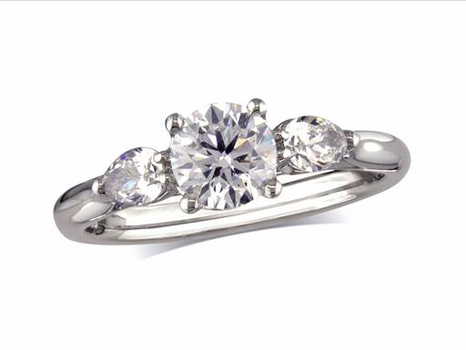 Platinum set single stone diamond engagement ring, with a certificated brilliant cut centre in a four claw setting, and one pear cut on each shoulder. Perfect fit with a wedding ring. Total diamond weight: 0.87ct