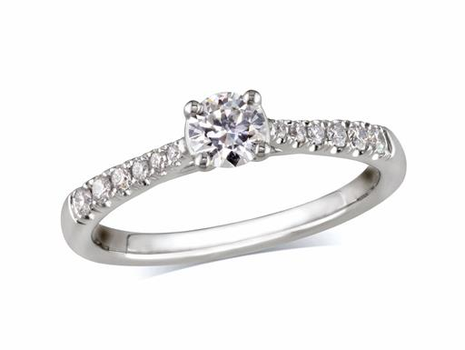 Platinum set single stone diamond engagement ring, with a certificated brilliant cut centre in a four claw setting, and diamond set shoulders. Perfect fit with a wedding ring. Total diamond weight: 0.45cts