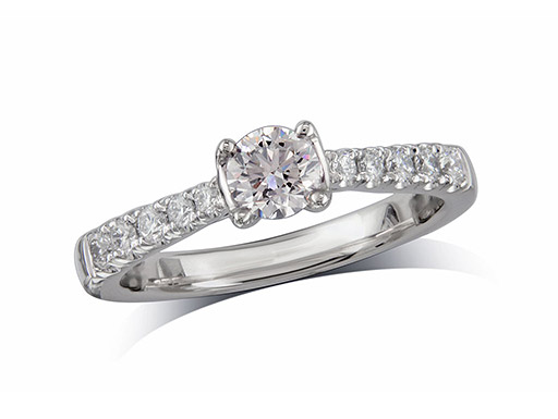 Platinum set single stone diamond engagement ring, with a certificated brilliant cut centre in a four claw setting, and diamond set shoulders. Perfect fit with a wedding ring. Total diamond weight: 0.63ct