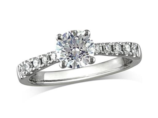 Platinum set single stone diamond engagement ring, with a certificated brilliant cut centre in a four claw setting, and diamond set shoulders. Perfect fit with a wedding ring. Total diamond weight: 1.16cts