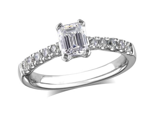Platinum set single stone diamond engagement ring, with a certificated emerald cut centre in a four claw setting, and diamond set shoulders. Perfect fit with a wedding ring. Total diamond weight: 0.96ct.