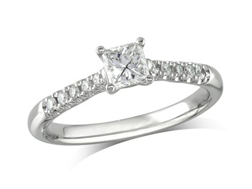 Platinum set single stone diamond engagement ring, with a certificated princess cut centre in a four claw setting, and diamond set shoulders. Perfect fit with a wedding ring. Total diamond weight: 0.50ct.