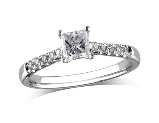Platinum set single stone diamond engagement ring, with a certificated princess cut centre in a four claw setting, and diamond set shoulders. Perfect fit with a wedding ring. Total diamond weight: 0.68ct.