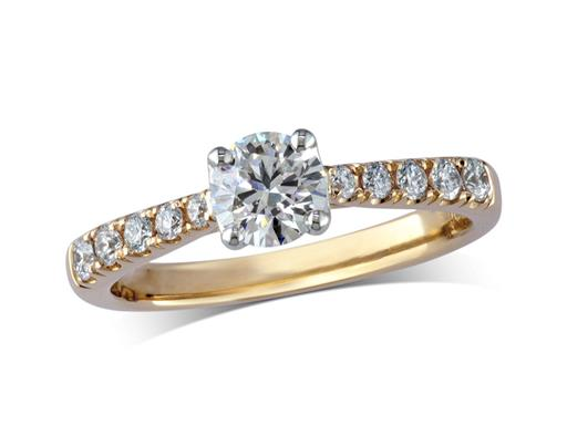 18 carat yellow gold set single stone diamond engagement ring, with a certificated brilliant cut centre in a four claw setting, and diamond set shoulders. Perfect fit with a wedding ring. Total diamond weight: 0.66ct.