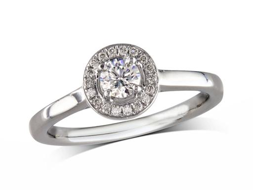 Platinum set diamond ring, with a certificated brilliant cut centre in a four claw setting, surrounded by a diamond set cluster. Perfect fit with a wedding ring. Total diamond weight: 0.30cts