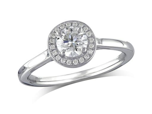 Platinum set diamond ring, with a certificated brilliant cut centre in a four claw setting, surrounded by a diamond set cluster. Perfect fit with a wedding ring. Total diamond weight: 0.57ct