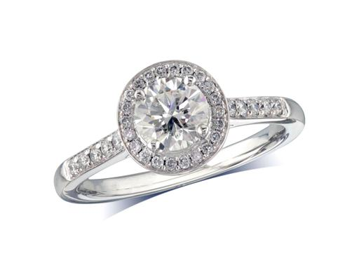 Platinum set cluster diamond ring with a certificated round brilliant cut centre diamond in a four claw setting, surrounded by smaller diamonds and with diamond set shoulders. Wedding ring fit. Total diamond weight 0.92ct.