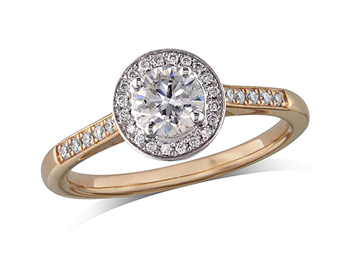 18 carat rose gold set diamond ring, with a certificated brilliant cut centre in a four claw setting, surrounded by a diamond set cluster and shoulders. Perfect fit with a wedding ring. Total diamond weight: 0.60ct.