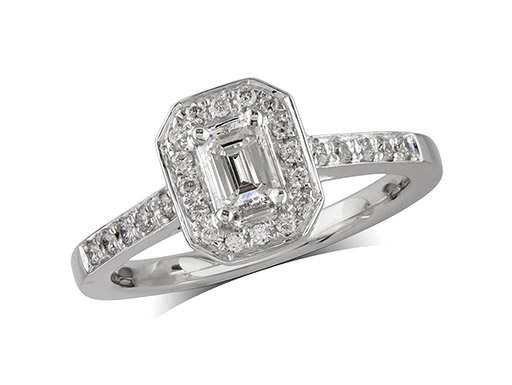 Platinum set diamond cluster ring, with a certificated Emerald cut centre stone in a claw setting with a brilliant cut diamond bezel and diamond set shoulders. Wedding ring fit. Total diamond weight: 0.50ct