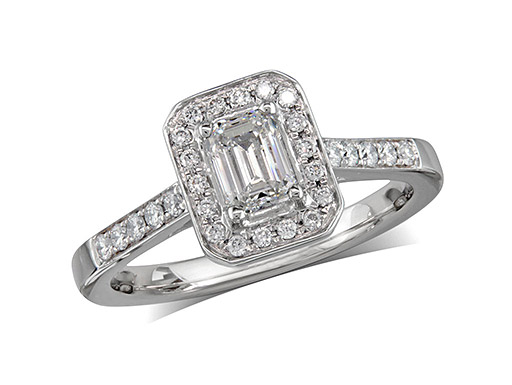 Platinum set diamond ring, with a certificated emerald cut centre in a four claw setting, surrounded by a diamond set cluster and shoulders. Perfect fit with a wedding ring. Total diamond weight: 0.72ct.