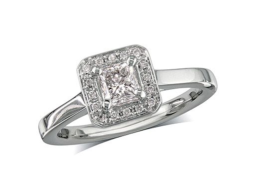 Platinum set diamond engagement ring, with a certificated princess cut centre in a four claw setting, surrounded by a diamond set cluster. Perfect fit with a wedding ring. Total diamond weight: 0.50ct.
