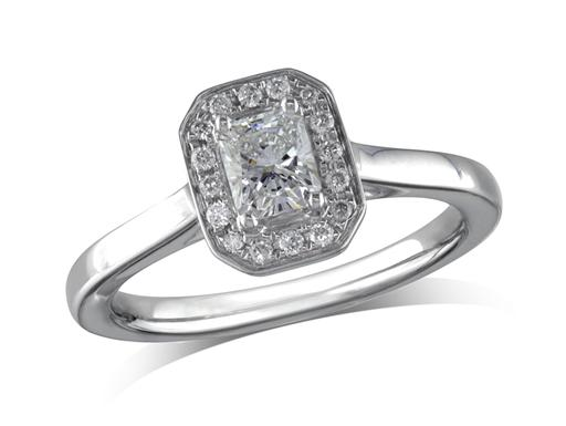 Platinum set diamond engagement ring, with a certificated radiant cut centre in a four claw setting, surrounded by a diamond set cluster. Perfect fit with a wedding ring. Total diamond weight:0.48ct