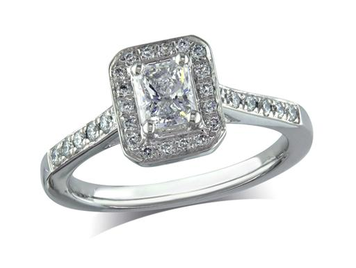 Platinum set diamond engagement ring, with a certificated radiant cut centre in a four claw setting, surrounded by a diamond set cluster and shoulders. Perfect fit with a wedding ring. Total diamond weight:0.66