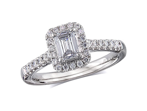 Platinum set diamond cluster engagement ring, with a certificated emerald cut centre in a four claw setting, with a surrounding diamond set bezel and diamond set shoulders. Perfect fit with a wedding ring. Total cluster diamond weight: 0.72