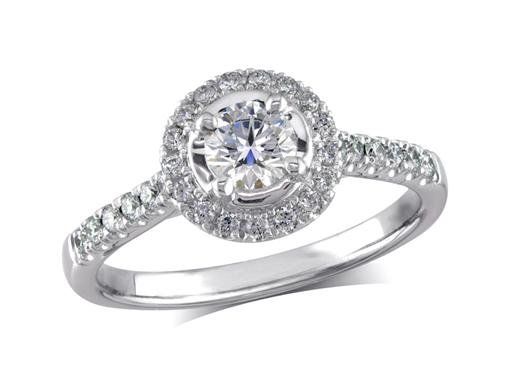 Platinum set cluster diamond ring with a certificated centre stone in a four claw setting with a diamond bezel and diamond set shoulders. Wedding ring fit. Total diamond weight 0.31ct.