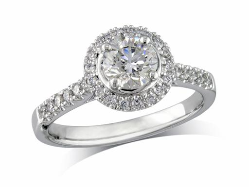 Platinum set diamond ring, with a certificated brilliant cut centre in a four claw setting, surrounded by a diamond set cluster and shoulders. Perfect fit with a wedding ring. Total diamond weight: 0.98ct.