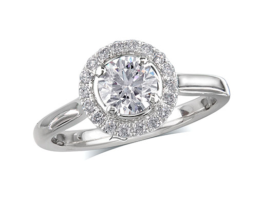 Platinum set diamond ring, with a certificated brilliant cut centre in a four claw setting, surrounded by a diamond set cluster. Perfect fit with a wedding ring. Total diamond weight: 0.74ct