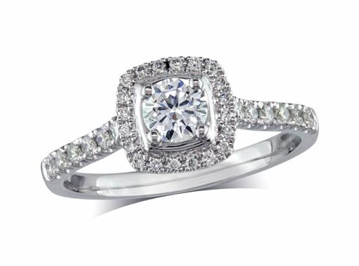 Platinum set diamond ring, with a certificated brilliant cut centre in a four claw setting, surrounded by a diamond set cluster and shoulders. Perfect fit with a wedding ring. Total diamond weight: