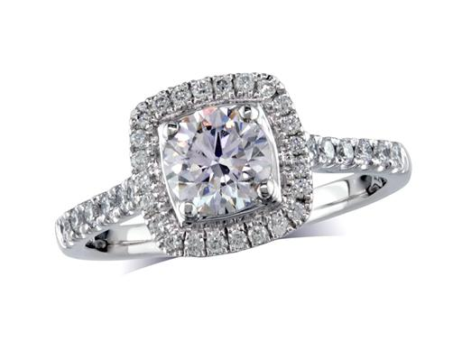 Platinum set diamond ring, with a certificated brilliant cut centre in a four claw setting, surrounded by a diamond set cluster and shoulders. Perfect fit with a wedding ring. Total diamond weight: 1.02ct.