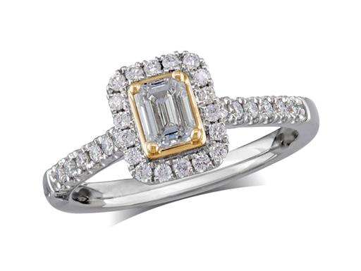 Platinum set diamond cluster engagement ring, with a certificated emerald cut centre in a four claw setting, with a surrounding diamond set bezel and diamond set shoulders. Perfect fit with a wedding ring. Total cluster diamond weight 0.68cts