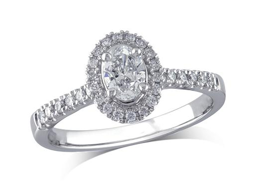 Platinum set diamond ring, with a certificated Oval cut centre in a 4 claw setting, surrounded by a diamond set cluster and shoulders. Perfect fit with a wedding ring. Total diamond weight: 0.60ct