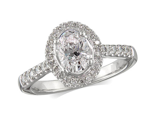 Platinum set diamond ring, with a certificated oval cut centre in a four claw setting, surrounded by a diamond set cluster and shoulders. Perfect fit with a wedding ring. Total diamond weight: 1.04ct