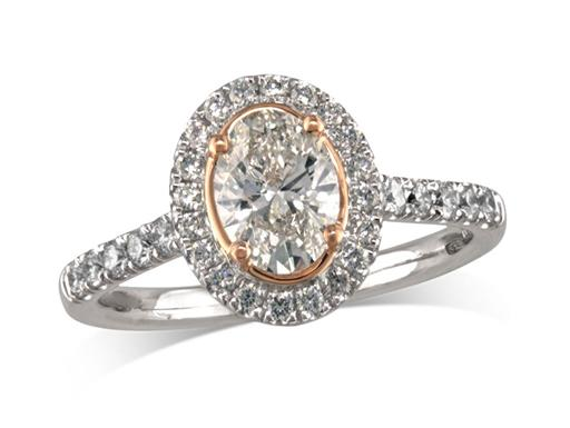 Platinum set diamond ring, with a certificated ovalcut centre in a four claw rose gold setting, surrounded by a diamond set cluster and shoulders. Perfect fit with a wedding ring. Total diamond weight:0.66cts