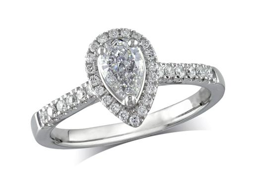 Platinum set diamond ring, with a certificated pear cut centre in a three claw setting, surrounded by a diamond set cluster and shoulders. Perfect fit with a wedding ring. Total diamond weight: 0.57ct