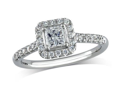 Platinum set diamond engagement ring, with a certificated princess cut centre in a four claw setting, surrounded by a diamond set cluster and shoulders. Perfect fit with a wedding ring. Total diamond weight: 0.70cts