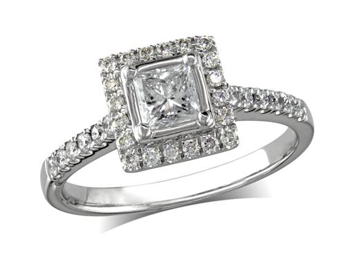 Platinum set diamond ring, with a certificated princess cut centre in a four claw setting, surrounded by a diamond set cluster and shoulders. Perfect fit with a wedding ring. Total diamond weight: 0.80ct.