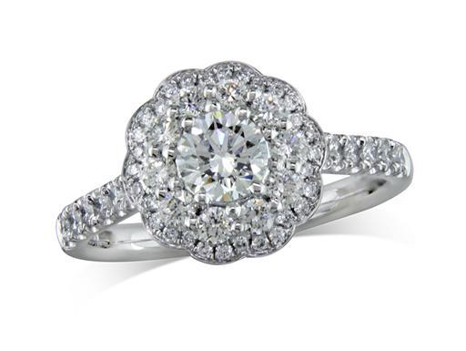 Platinum set diamond cluster engagement ring, with a certificated brilliant cut centre in a claw setting, surrounded by ten brilliant cut diamonds and a surrounding diamond set bezel. Perfect fit with a wedding ring. Total cluster diamond weight: 1.00ct.