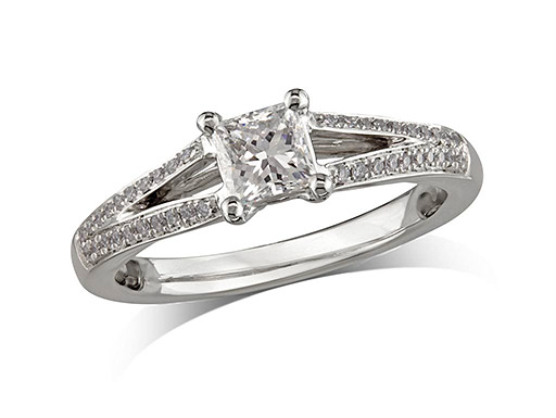 Platinum set single stone diamond engagement ring, with a certificated princess cut centre in a four claw setting, and diamond set shoulders. Perfect fit with a wedding ring. Total diamond weight: 0.64ct.