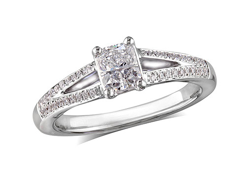 Platinum set single stone diamond engagement ring, with a certificated cushion cut centre in a four claw setting, and diamond set shoulders. Perfect fit with a wedding ring. Total diamond weight: 0.83ct.