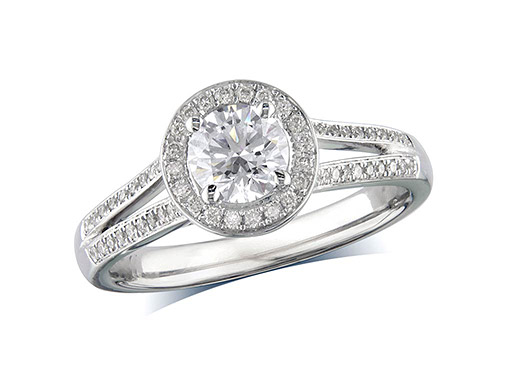 Platinum set diamond ring, with a certificated brilliant cut centre in a four claw setting, surrounded by a diamond set cluster. Perfect fit with a wedding ring. Total diamond weight 0.66cts: