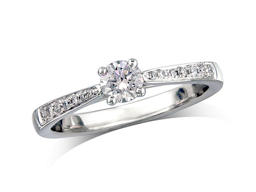 Platinum set single stone diamond engagement ring, with a certificated brilliant cut centre in a four claw setting, and diamond set shoulders. Perfect fit with a wedding ring. Total diamond weight: 0.36ct